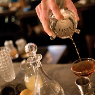Cocktail being poured from a shaker