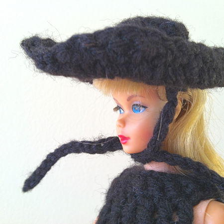 close up of Barbie in black crocheted hat