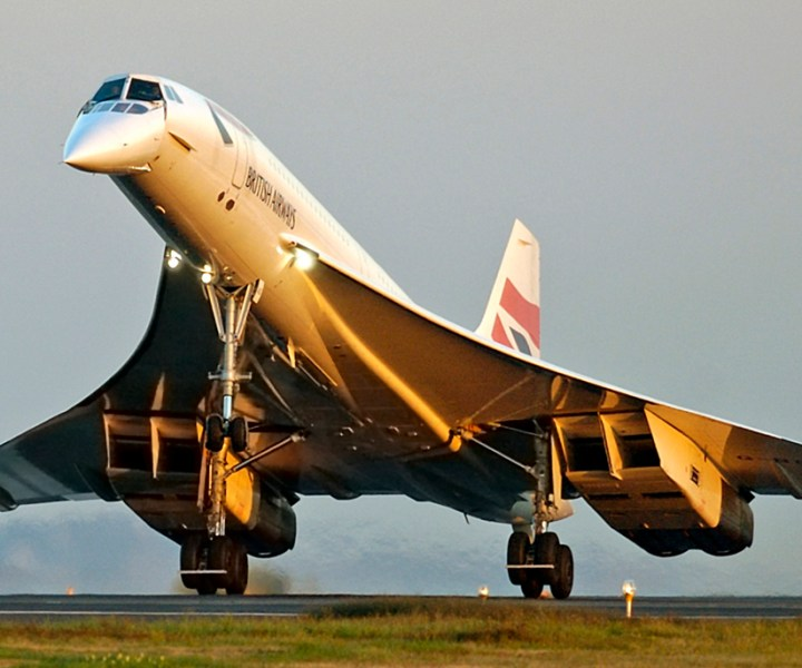 The British Airways owned Concorde supersonic jet aircraft lands in Boston, Wednesday, Oct. 8, 2003, as part of its farewell tour.  The plane is to be retired from commercial service before the end of the year. (AP Photo/Robert E. Klein)
