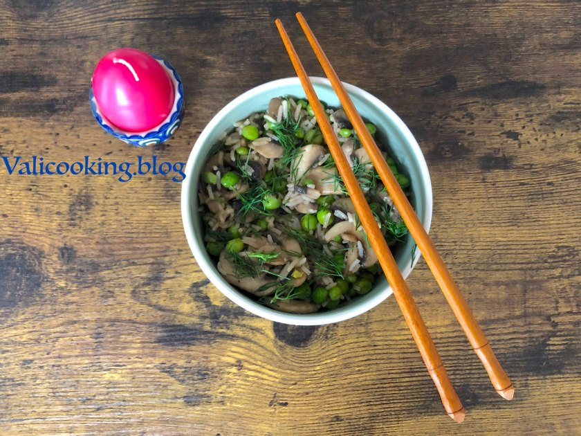Warm rice salad with mushrooms and green peas