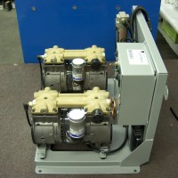 Side view of Auxiliary Compressor on a table.