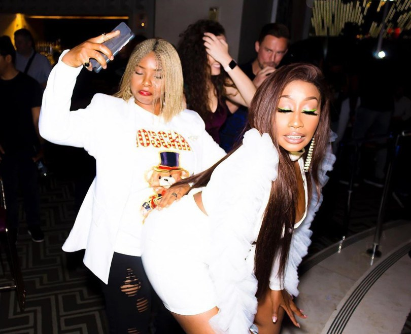 What Is Yemi Alade Doing With Victoria Kimani In This Picture?
