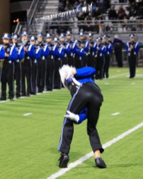 Junior Drum Major catching the behind the back baton