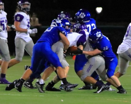 Adam Smith and Trent Anderson make tackles... only one has the guy with the ball