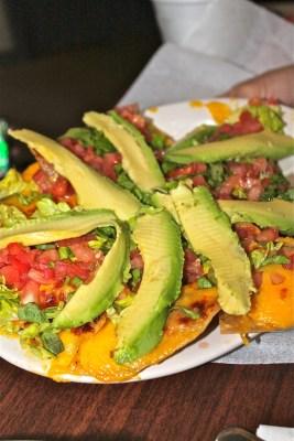 The Vermillion nachos covered with delicious avocado.