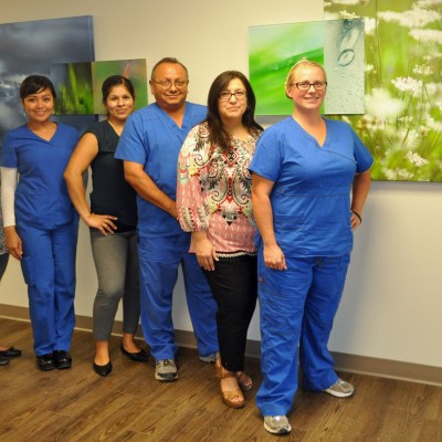 Geriatric Behavioral Health Unit staff at Valley Baptist Medical Center in Harlingen stand in front of some of the artwork displayed to give the 12-bed unit a warm atmosphere.