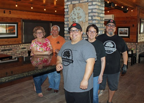 The Smoking Oak owner Mario Dominguez Jr. (right) has made the business a family affair. From left to right are his mother and father, Maddy and Mario Sr.; brother Santana and aunt Maddie. They are standing in an addition that will double the restaurant's seating capacity.