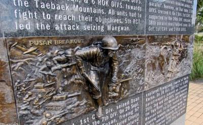 A Marine jumps into action on Clark's Korean War plaque at the Veterans War Memorial of Texas. (VBR)