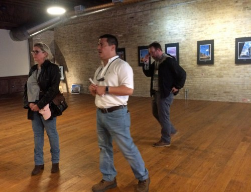 Inside the restored Putegnat Building in Brownsville, Fernando Balli talks about the 1868 building. Designer Tina Garbo Bailey, who collaborated with Balli, stands to his right. (VBR)