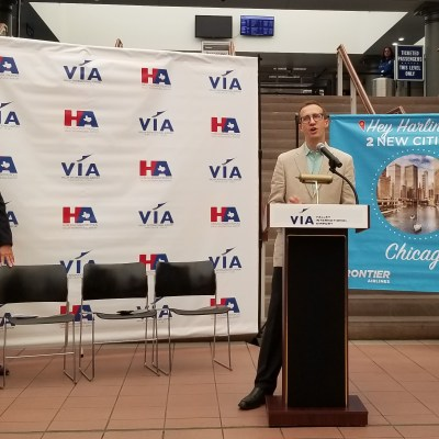 Frontier Airlines Chief Commercial Officer Daniel Shurz takes the podium in announcing the new Frontier Airlines service at VIA.