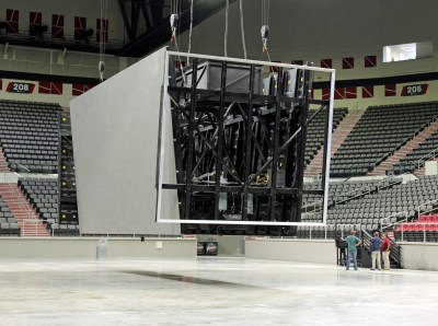 The large LED scoreboard receives last-minute adjustments. (VBR)