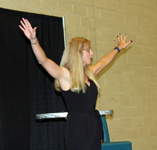 Bridgett Krause, founder and CEO of the Dream Big Facility, gestures during a presentation at the McAllen Business Expo. (VBR)