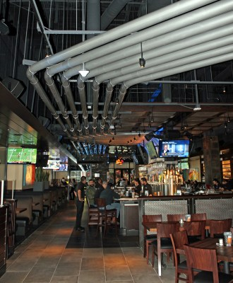 Draft beer is delivered to the bar through lines running through conduits along the ceiling of the Yard House. (VBR)