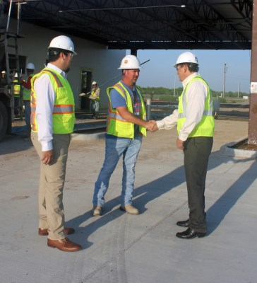 Partners Alfredo Cantu (left) and Rene Capistrain (right) talk with Alex Cantu of Golden Concrete on the site of a credit union under construction in Brownsville. (VBR)
