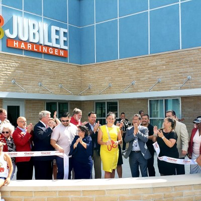 Principal Tanya Perez cuts the ribbon as school administrators, area dignitaries, teachers and students celebrate the opening of the new Jubilee Harlingen campus.