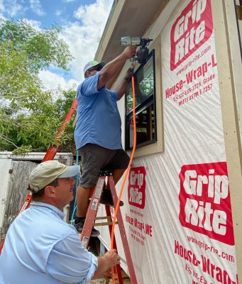 Roland Pecina, Disaster Recovery Construction manager with Rio Texas Response, installs framing around a window of a new home. (VBR)