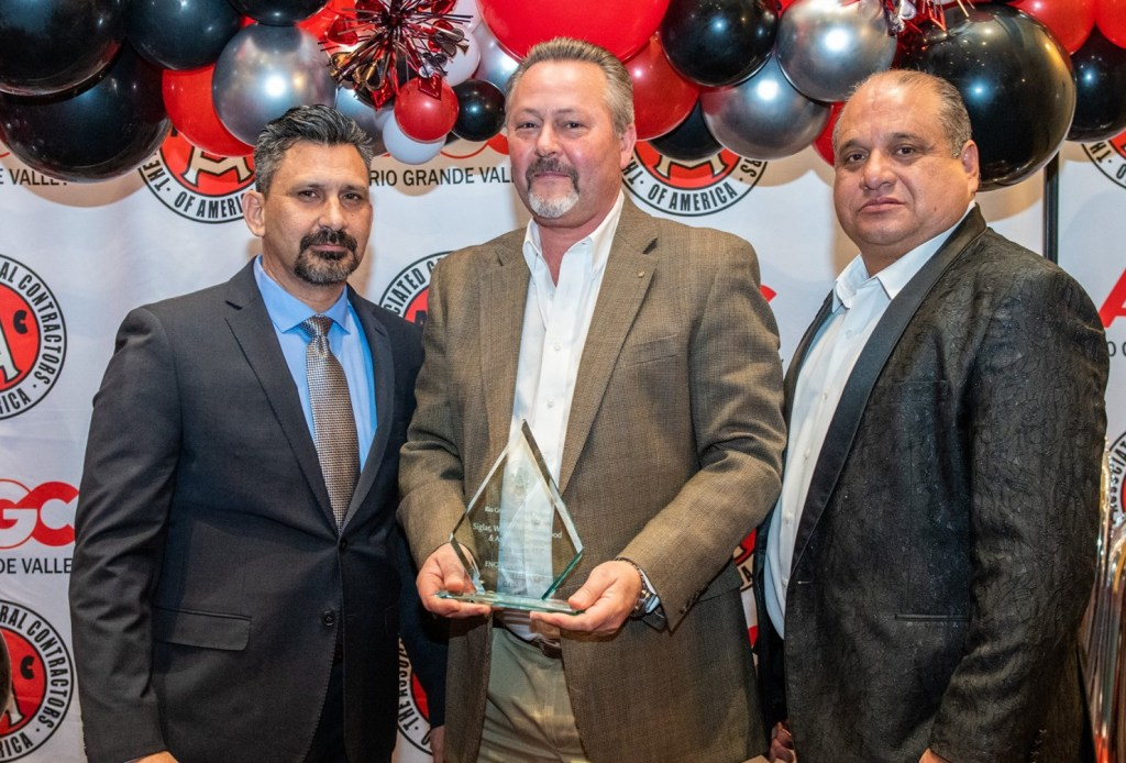 Randall Winston accepts the 2019 Civil Engineering Firm of the Year award from the Associated General Contractors of America Rio Grande Valley Chapter.