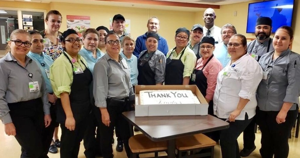 """Valley Baptist Medical Center staff in Brownsville with a """"thank you"""" cake, compliments of Linda's Cakes & Desserts Speciality Shop. (Courtesy)"""