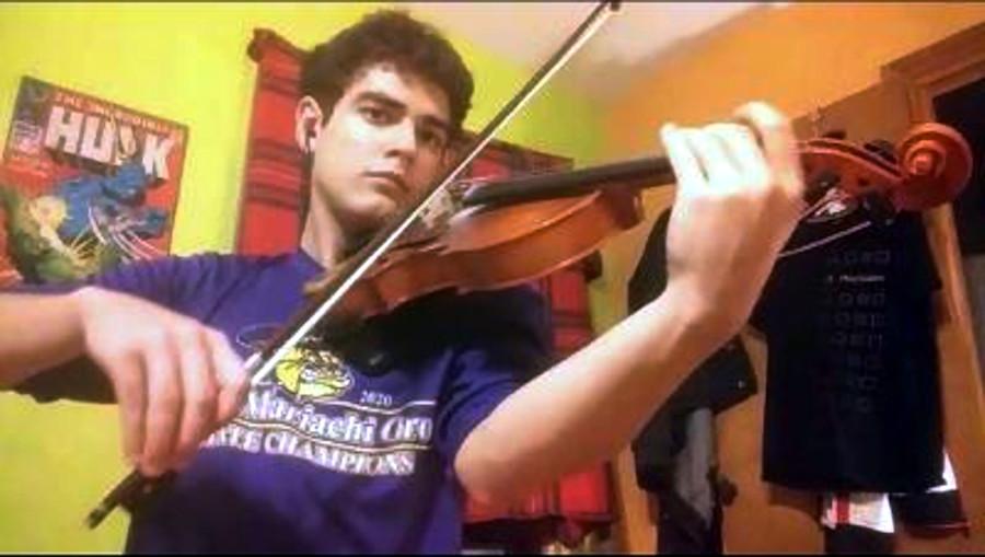 Laert Musollari, 11th-grade violinist, records his individual video, contributing to a virtual performance of McAllen High School's Mariachi Oro.