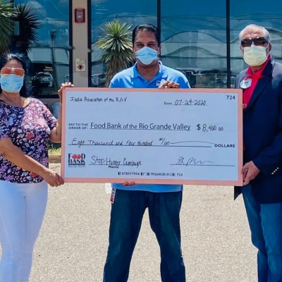 Hari Namboodiri and Shima Choudhary, president and secretary of the India Association of Rio Grande valley present a check to Food Bank CEO Stuart Haniff. Joining them are India Association board members Sreekanth Nangavaram and KV Kanneganti.