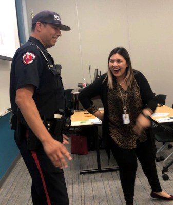 Officer Michael Medrano of the STC Department of Public Safety learns how Laughter Yoga reduces stress hormones and increases oxygen levels during Crisis Intervention Team Training and Self-Care for Law Enforcement with Laughter Yoga ambassador Mayra Avila.