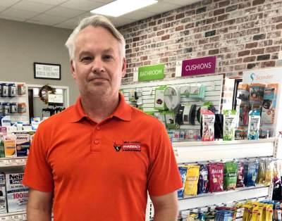 Pharmacist John Hinkle at his Mid-Valley Pharmacy in Mercedes.