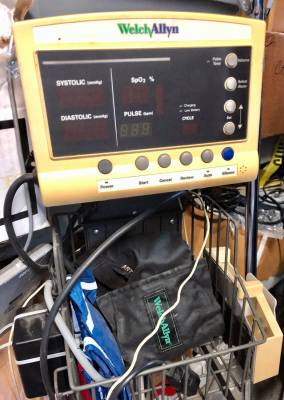 Blood pressure machines are among the medical equipment items in the warehouse.