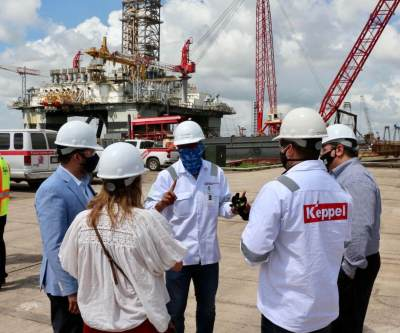 Company and local officials confer recently at AmFELS shipyard. (Courtesy)