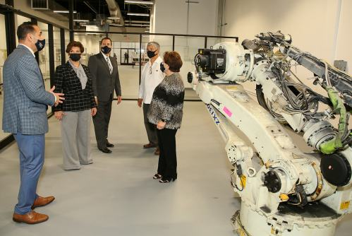 TSC Dean of Science, Technology, Engineering and Mathematics and Career and Technical Education Murad Abusalim gives a tour of the new Industrial Mechanics and Maintenance Technology facility. Joining him are TSC Board of Trustees Chairwoman Adela Garza, TSC President Jesus Roberto Rodriguez, and trustees Ruben Herrera and Delia Saenz.