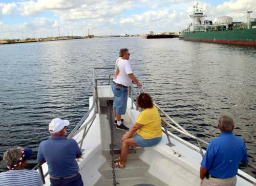 Boat passengers get a first-hand look at the sites of the Port of Brownsville.