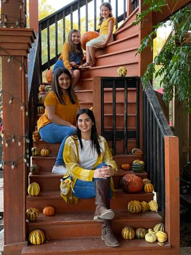 Priscilla Cavazos, bottom step, with her three daughters, Kyliee, Charlotte and Faith.