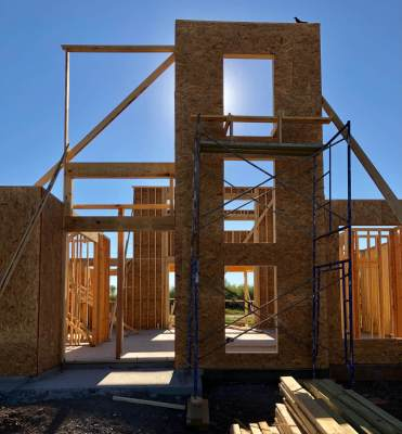 The sun rises behind home construction in Harlingen.