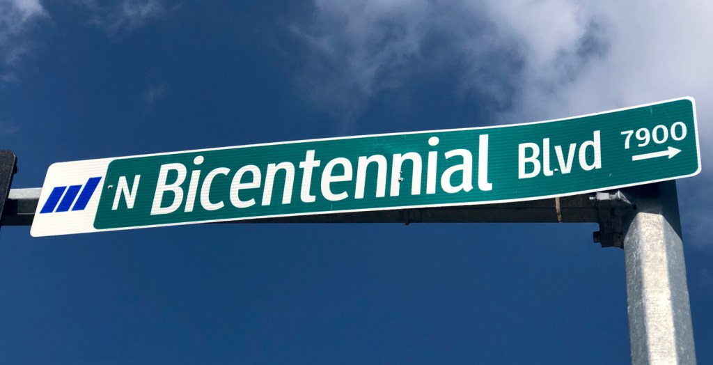 Bicentennial Boulevard street sign points northward in its intersection with Auburn Avenue.
