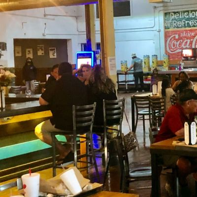 SMOKE BBQ patrons enjoy great food with slices of local history featured all around them.