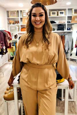 Iselle Perez's boutique is an addition to her delivery of fashions for professional women in Brownsville.