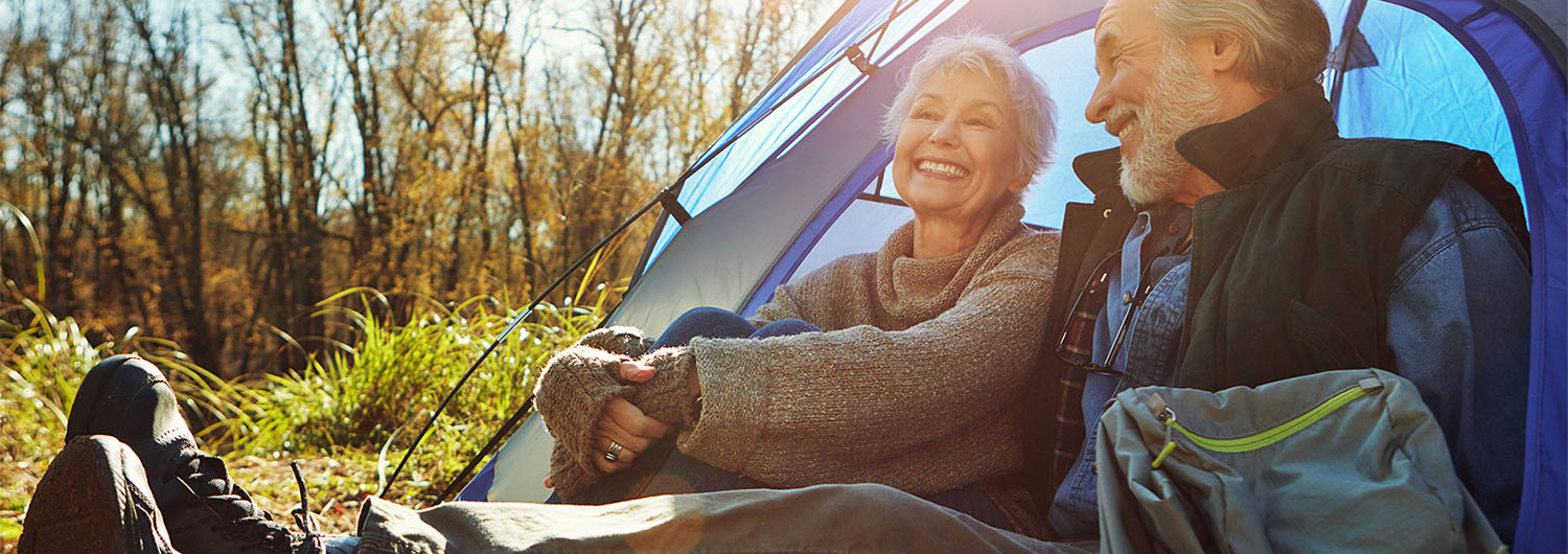 Senior couple camping together in the wilderness