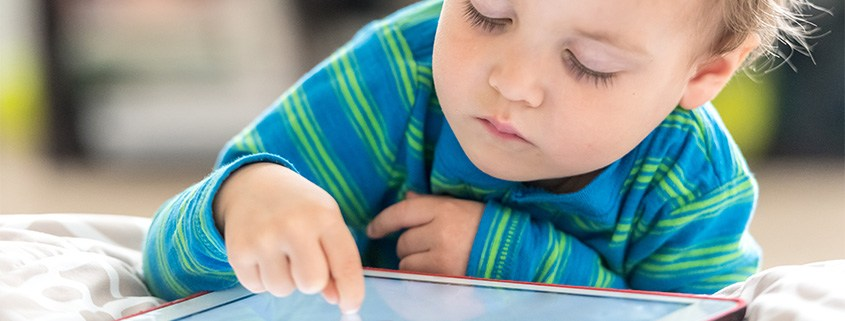 Child having screen time on a tablet