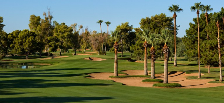 Wigwam Gold #3 hole. This jewel of the desert is among the Southwest's last remaining Phoenix golf courses & resorts that was built for a pure golf experience. Canals, streams and lakes cascade through the journey. The shadows cast on greens and bunkers are from majestic parkland trees, not multi-story resort buildings.