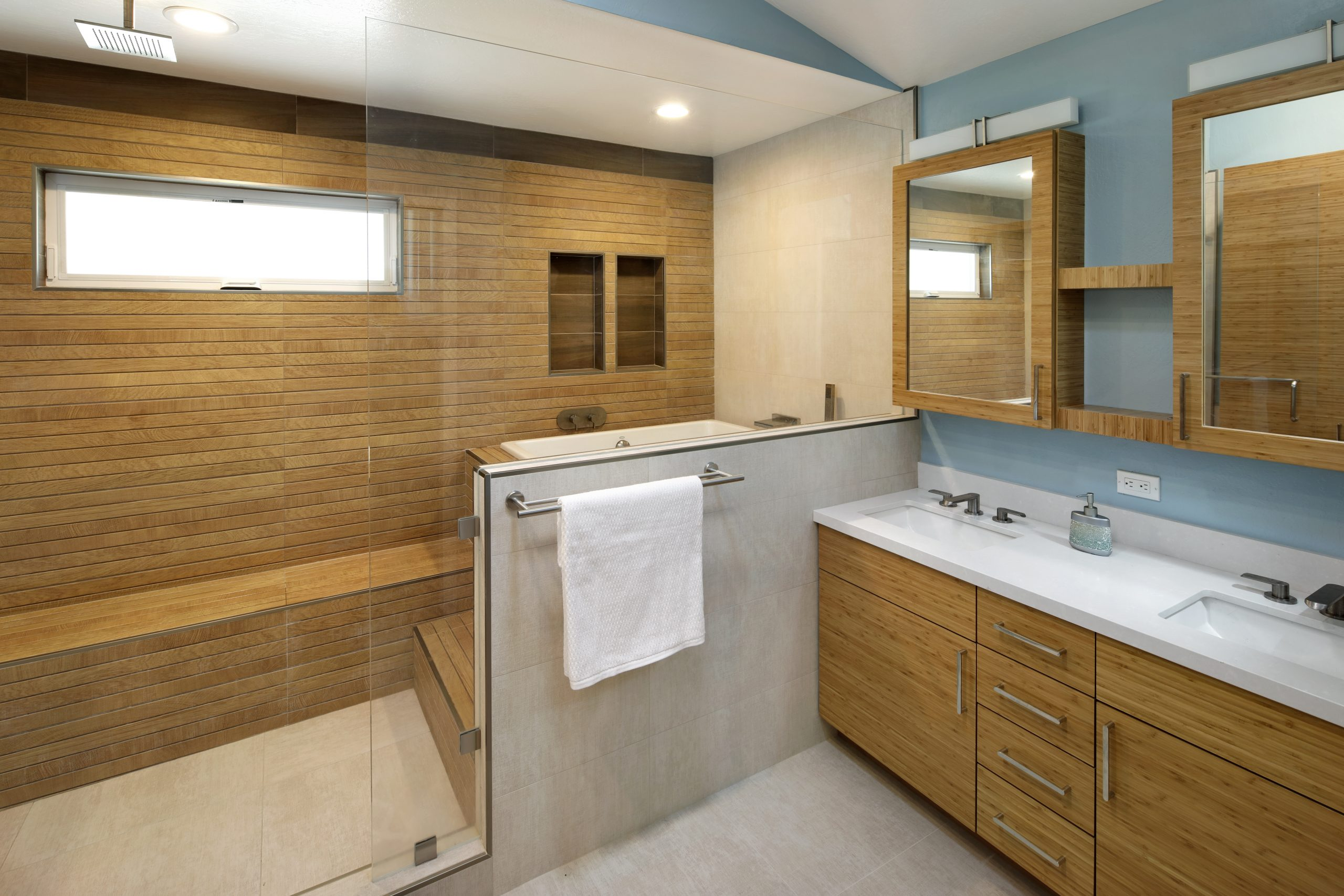 A Japanese style bathroom renovation with wooden shower and tub.