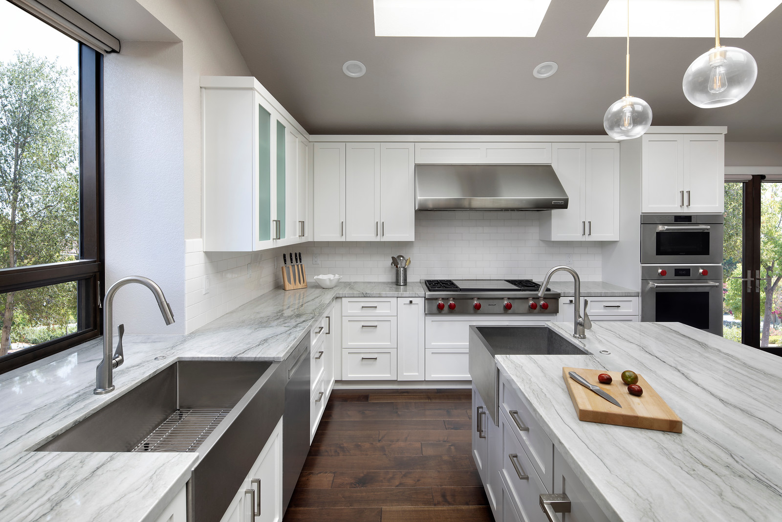 A kitchen with quartz counter tops and stainless steel appliances.