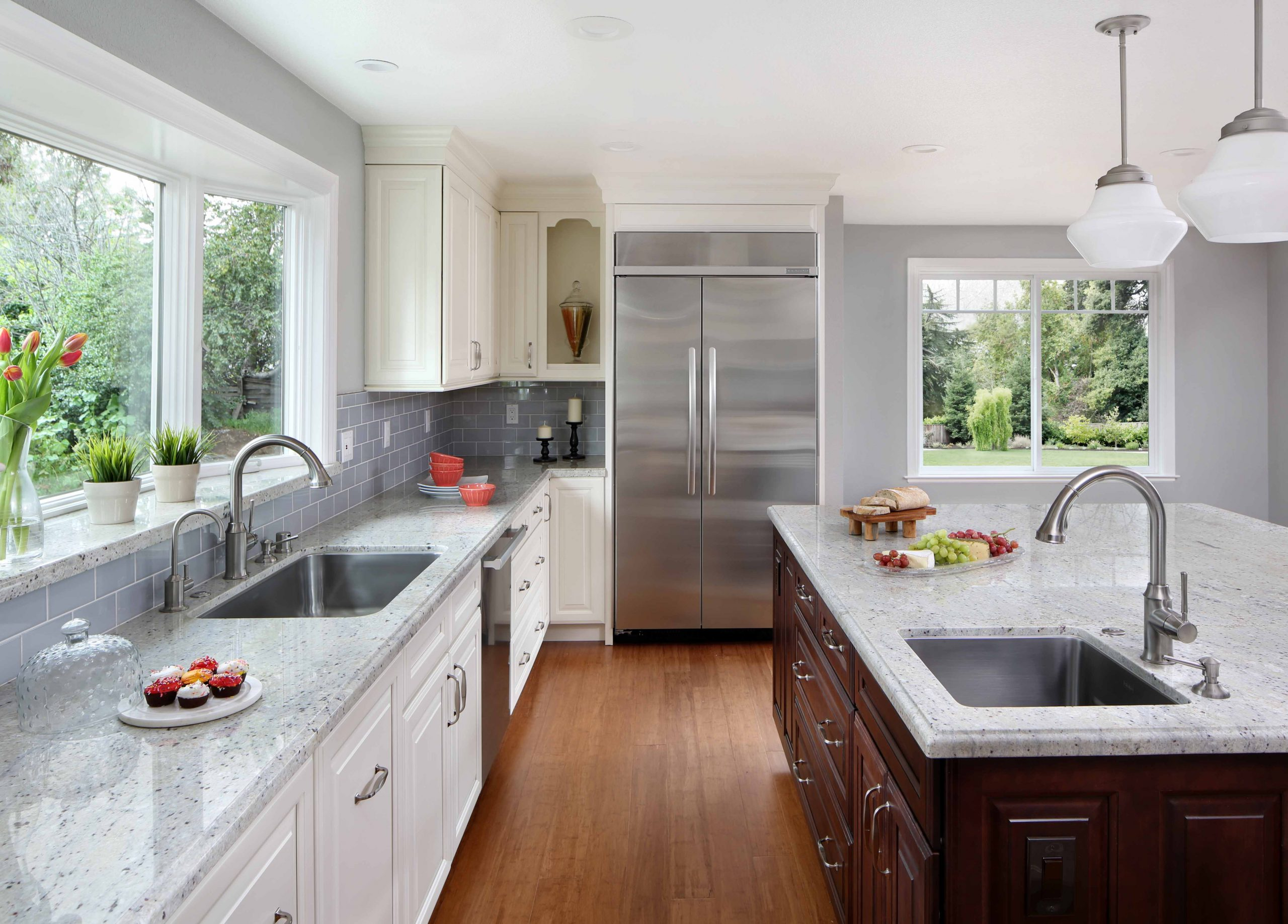 A brand new kitchen with two sinks.