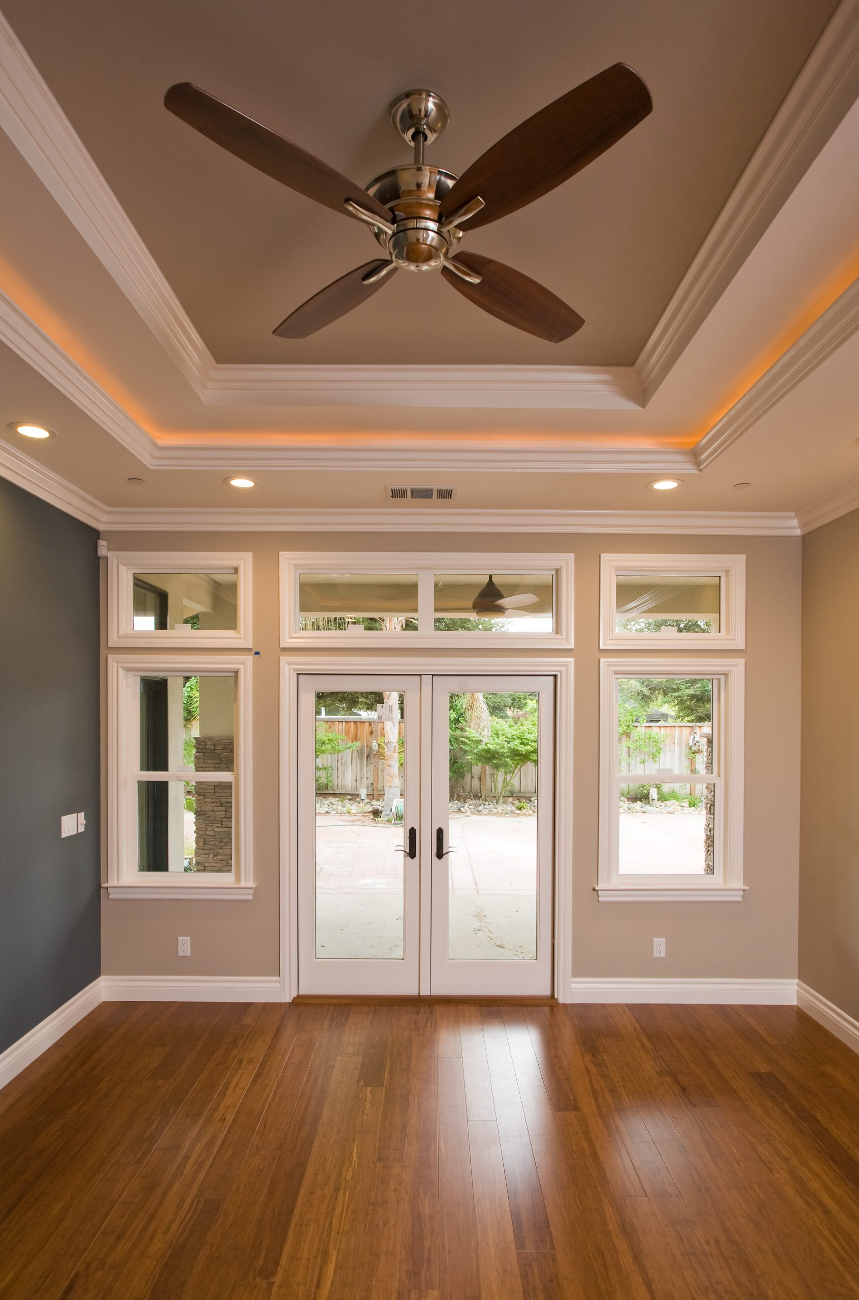 A living room with hardwood floors and recessed ceilings.