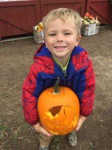 Bat carved into pumpkin.