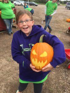 Girl with Spooky Pumpkin