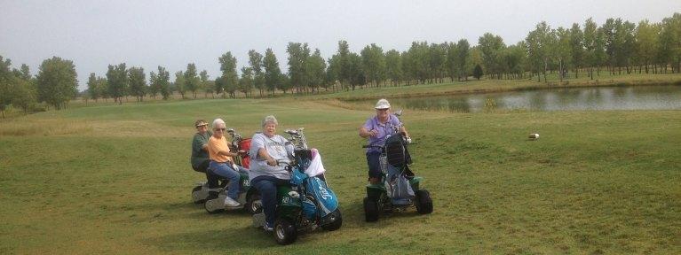 Ladies riding golf carts
