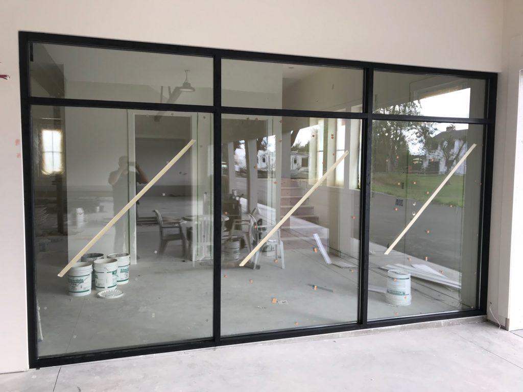 Black Aluminum Storefront Installed In Abbotsford Valley