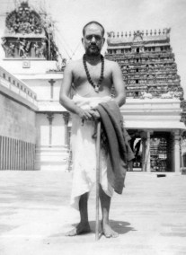 Swamigal in front of a Shiva temple
