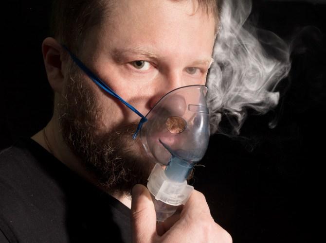 glutathione inhalation - 2 (man using a nebulizing mask)