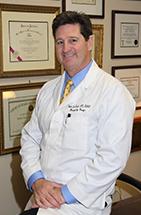 Robert J. Troell, MD.