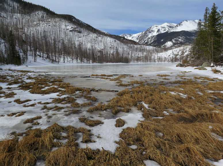 Cub Lake frozen in the winter located in the popular Rocky Mountain National Park in Estes Park, Colorado